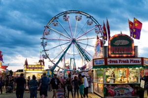 Illuminated ferris wheel at a county fair in midwestern USA